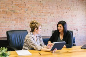 Image of two women at a business meeting